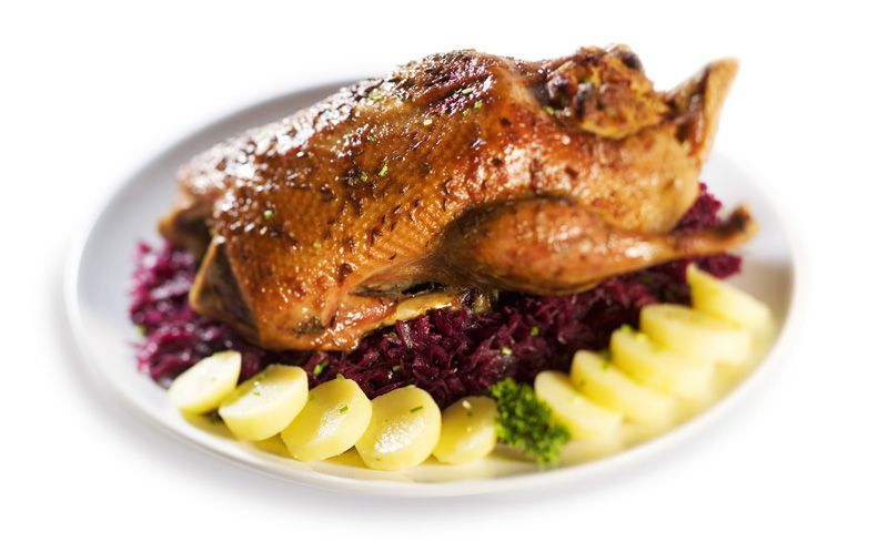 Roast duck with dumplings and cabbage
