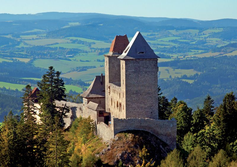 Look out from the massive towers of Kašperk Castle into the mysterious forests of Šumava.
